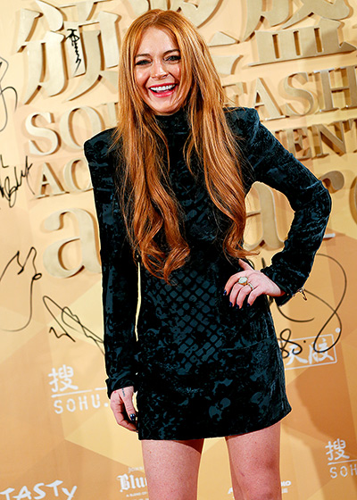 Lindsay Lohan green velvet long sleeved velvet holiday party dress