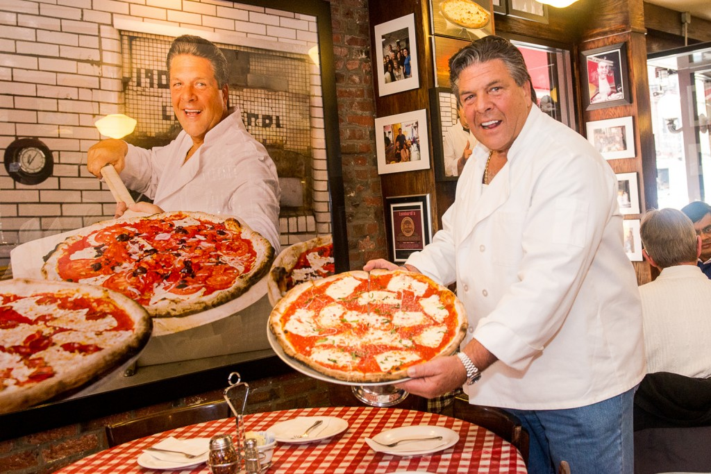 Owner of Lombardis  John Brescio with a classic margherita pie