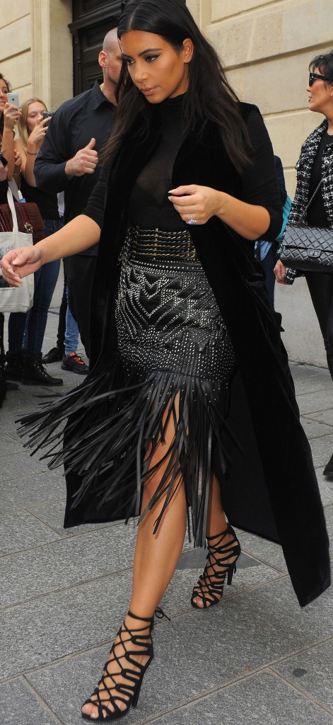 Kim Kardashian seen leaving Balmain black leather fringed skirt