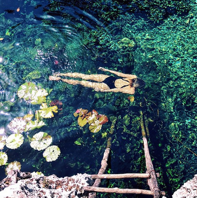 tuulavintage swimming in mexico in a cenote fashion blogger seaside fashion